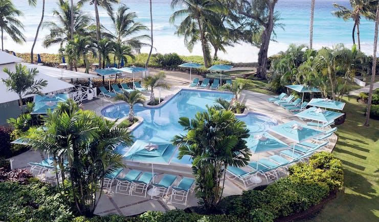 Turtle Beach Barbados pool palm trees overlooking the ocean