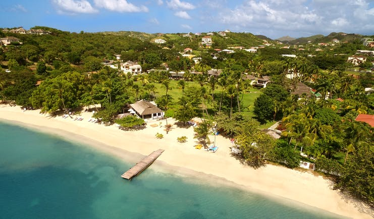 Caribbean sandy beach and jetty