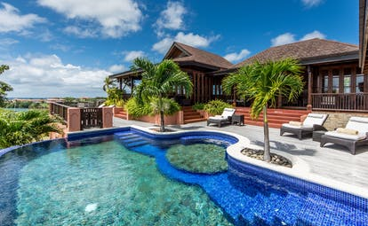 Villa with pool and palm trees