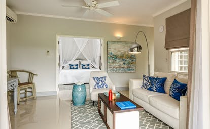 White room with blue cushions