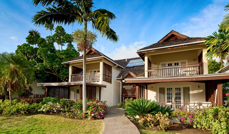 Two storey wooden balconies and palm