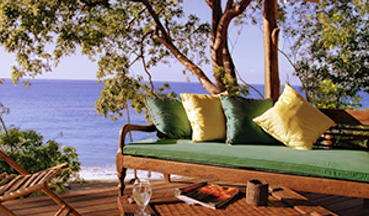 Laluna Grenada cottage veranda outdoor seating area overlooking the beach