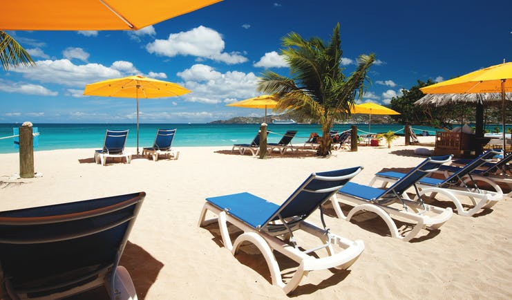 Mount Cinnamon Grenada beach sun loungers and umbrellas on the sand