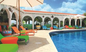 Mount Cinnamon Grenada pool sun loungers and umbrellas