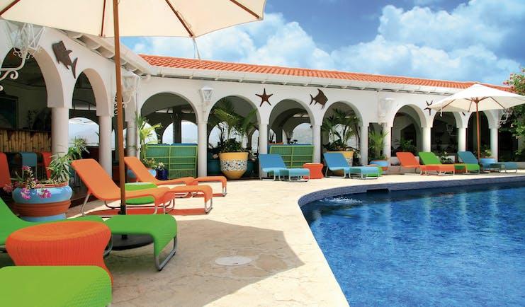 Mount Cinnamon Grenada pool sun loungers and umbrellas
