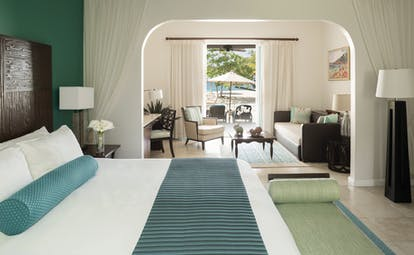 Spice Island Grenada beach suite bedroom and living area opening on to beach