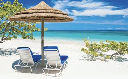 Spice Island Grenada sun loungers on the beach in the shade of a beach umbrella