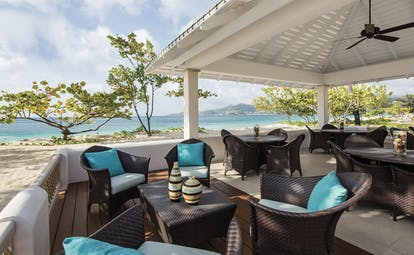 Spice Island Grenada outdoor seating beach terrace tables and chairs overlooking the ocean