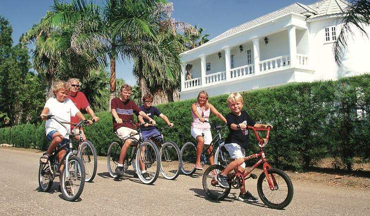 Half Moon Jamaica family cycling activity pavement hedge trees