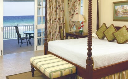 Half Moon Jamaica suite bedroom four poster bed private balcony overlooking sea