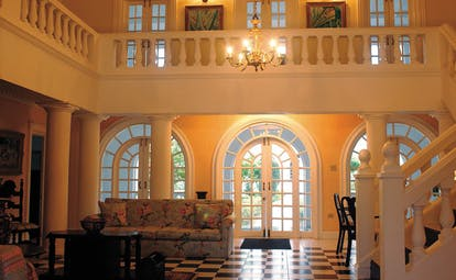 Half Moon Jamaica villa entrance hall sofa stairs tiles colonial décor