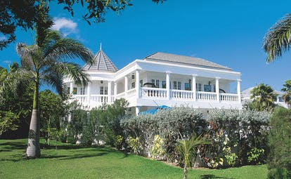 Half Moon Jamaica villa exterior and gardens lawns and trees