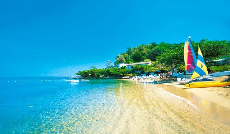 Round Hill Jamaica boats on the beach sandy beach clear blue ocean