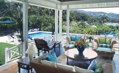 Round Hill Jamaica pineapple suite terrace large seating area pool in background