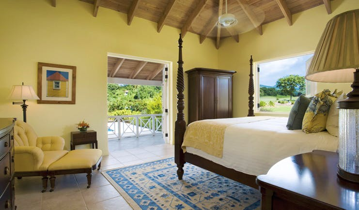 Four Seasons Nevis bedroom double bed leading out to balcony garden view out of window