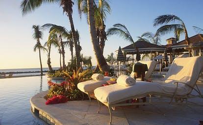 Four Seasons Nevis garden pool sun loungers ocean in background