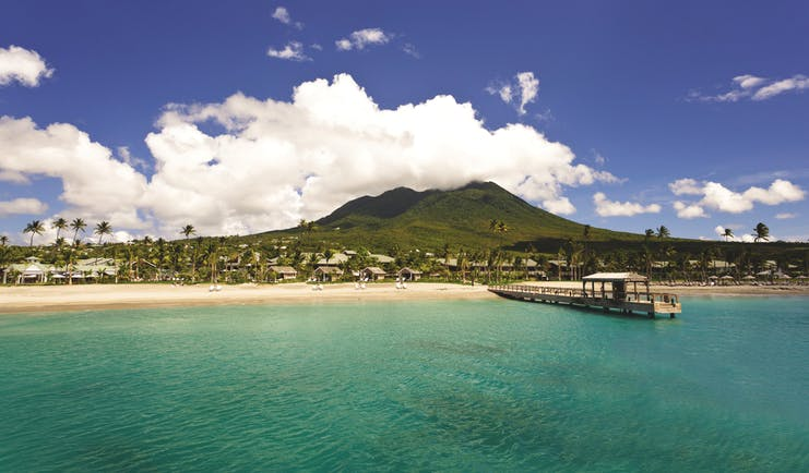 Four Seasons Nevis resort from the ocean mountains in background