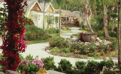 Four Seasons Nevis spa gardens pathways pink flowers green shrubbery