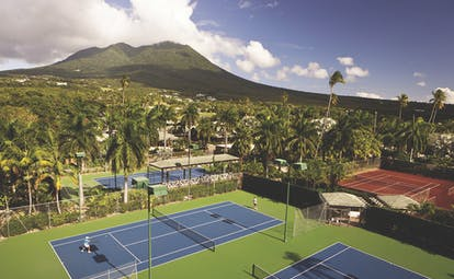 Four Seasons Nevis tennis courts mountain in the background