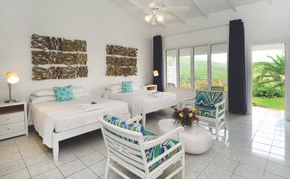 Montpelier Plantation Nevis plantation room twin bedroom with doors leading out to garden