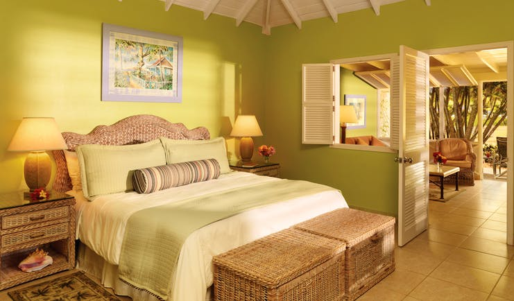 Nisbet Plantation Nevis deluxe garden suite double bed and lounge area