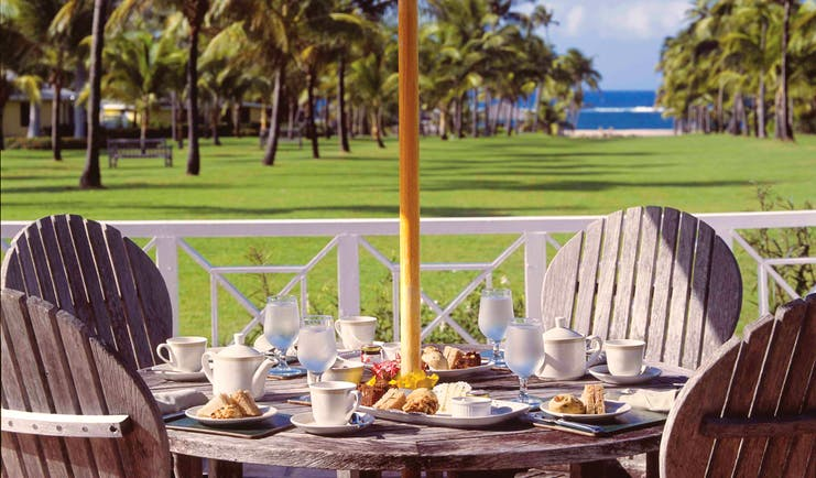Nisbet Plantation Nevis afternoon tea outdoor dining with views across the lawns and toward the ocean