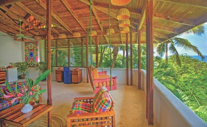 Anse Chastanet St Lucia deluxe hill terrace swinging chair and seating area overlooking hillside and ocean