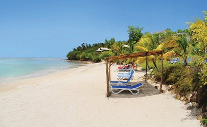 Calabash Cove St Lucia sandy beach clear ocean water sun loungers