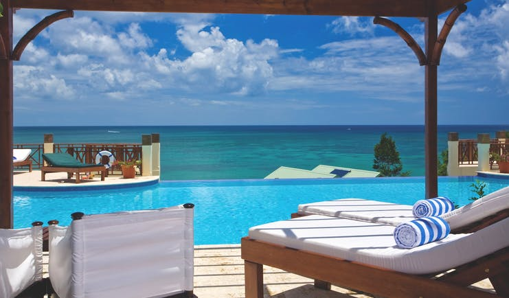 Calabash Cove St Lucia swim up junior suite terrace lounge chairs infinity pool overlooking the ocean