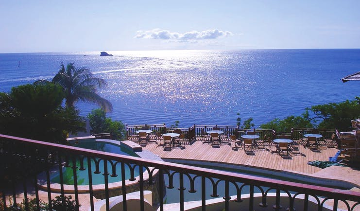 Cap Maison St Lucia view of Caribbean sea from roof top terrace pool and decking