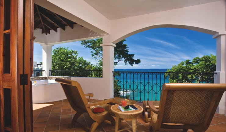 Cap Maison St Lucia villa suite terrace sun loungers overlooking the ocean hot tub