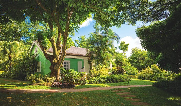East Winds Inn St Lucia deluxe cottage exterior lawns trees and greenery