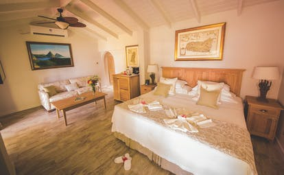 East Winds Inn St Lucia ocean view suite king size bed and lounge area