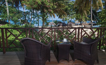 East Winds Inn St Lucia ocean view terrace outside seating area with views of beach and ocean