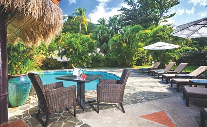East Winds Inn St Lucia poolside seating sun loungers table and chairs