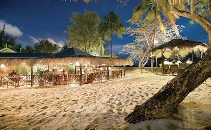 East Winds Inn St Lucia restaurant dining on the beach by night