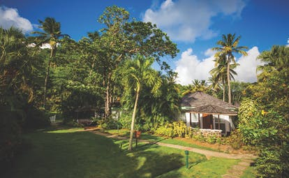 East Winds Inn St Lucia superior cottage exterior surrounded by greenery