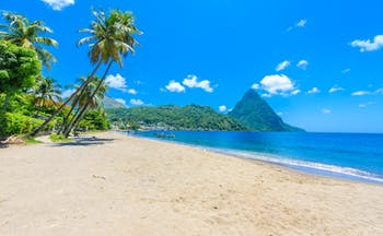 Paradise Beach in Saint Lucia, sand, sea, palm trees, Piton in background