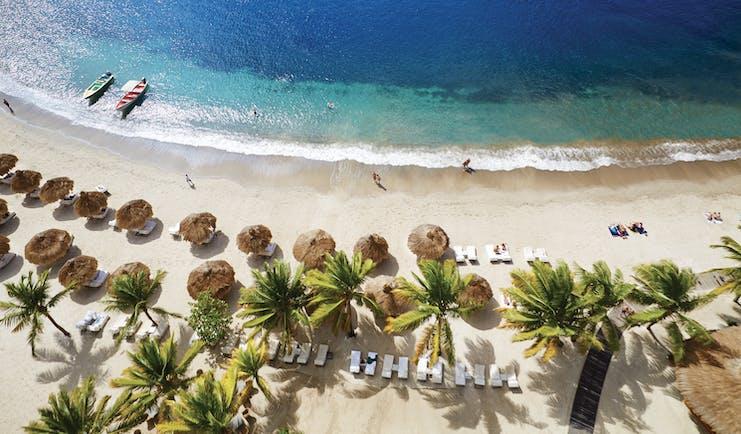 Sugarbeach St Lucia aerial shot of beach sun loungers and umbrellas
