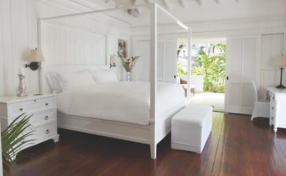 Sugarbeach St Lucia villa bedroom four poster bed doors opening to terrace