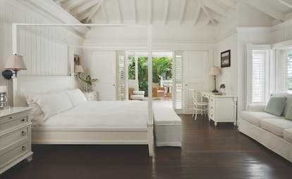 Sugarbeach St Lucia villa interior bed and bedroom furniture sofa and outdoor seating area