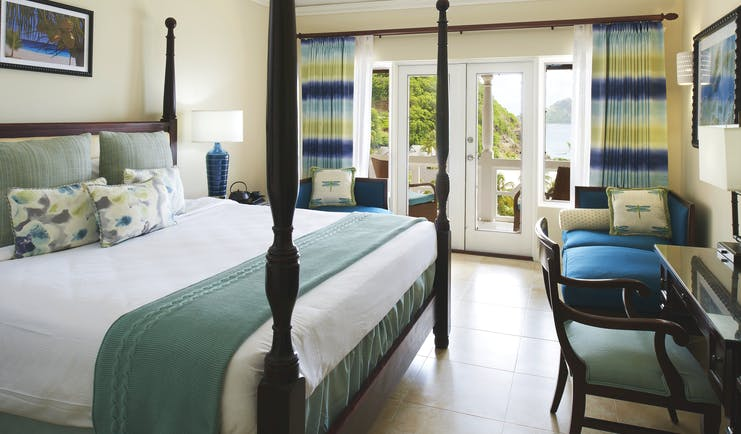 The Body Holiday St Lucia luxury ocean view room opening to balcony overlooking the sea