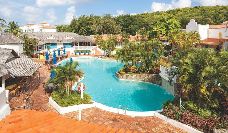 Windjammer Landing St Lucia pool with outdoor seating areas and palm trees