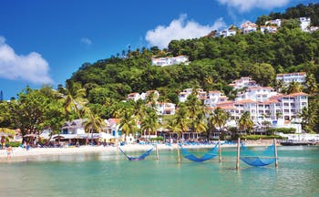 Windjammer Landing St Lucia view of resort from the sea hotel complex beach and hillside