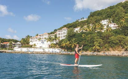 Windjammer Landing St Lucia man paddle boarding on the sea