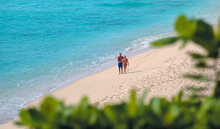 La Samanna St Martin beach couple white sand ocean