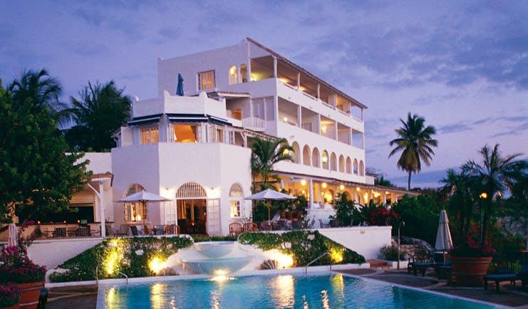 La Samanna St Martin hotel exterior pool white building balconies gardens