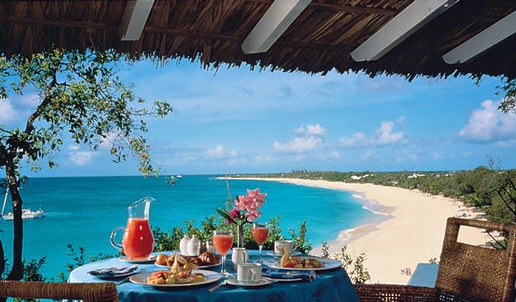 La Samanna St Martin outdoor dining covered terrace breakfast ocean view