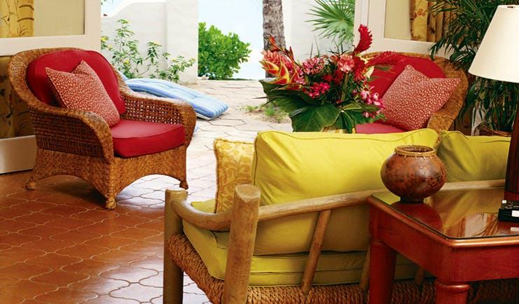 La Samanna St Martin terrace wicker armchairs floral arrangements