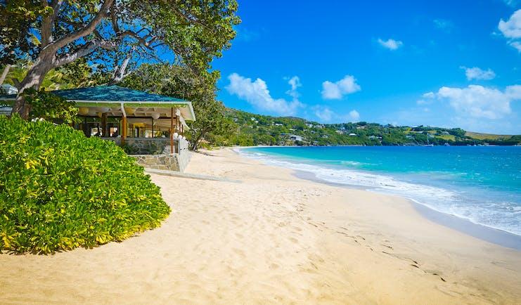 Bequia Beach Hotel Beach, golden sands, bright blue sea, trees and greenery